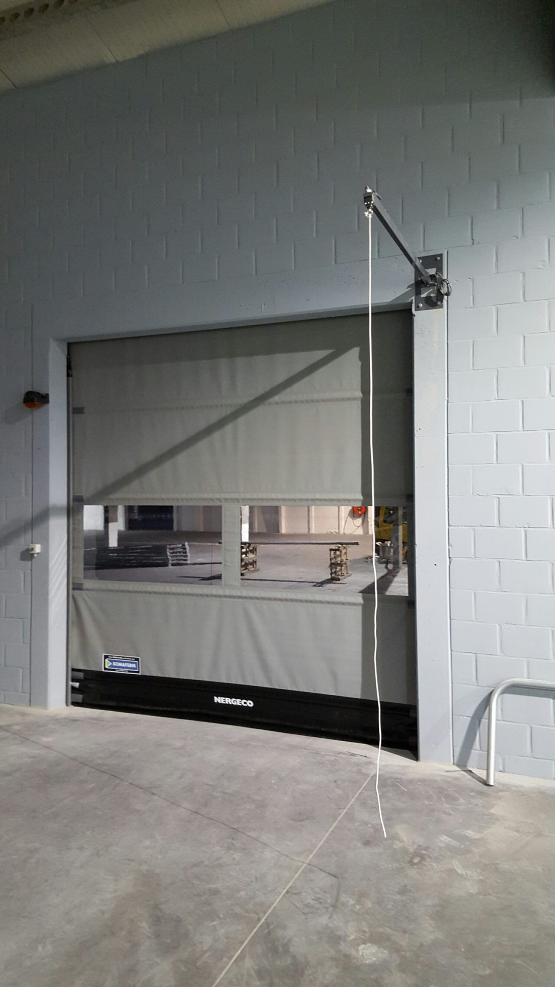 Porte rapide nergeco assa abloy en composite somaferm for Porte a enroulement